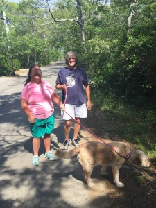 Friends helping friends: Kendra starts a new tradition, walking Liza's dog Fenway with August director/July helper extraordinaire, Jack.