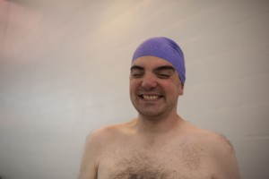Jon was less-than-happy to put a tiny swimcap on his head, but more-than-happy to show it off afterwards.